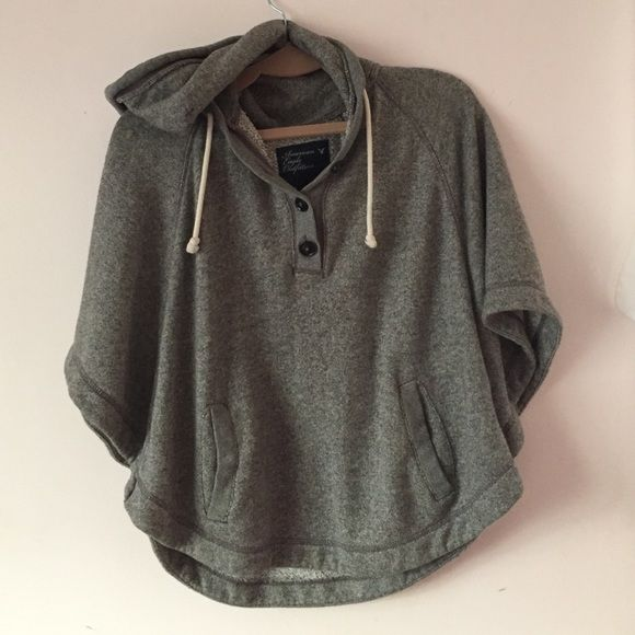 PONCHO HOODIE SALE!!! Super soft, American eagle grey poncho hoodie, size small with three top buttons and a drawstring American Eagle Outfitters Tops Sweatshirts & Hoodies