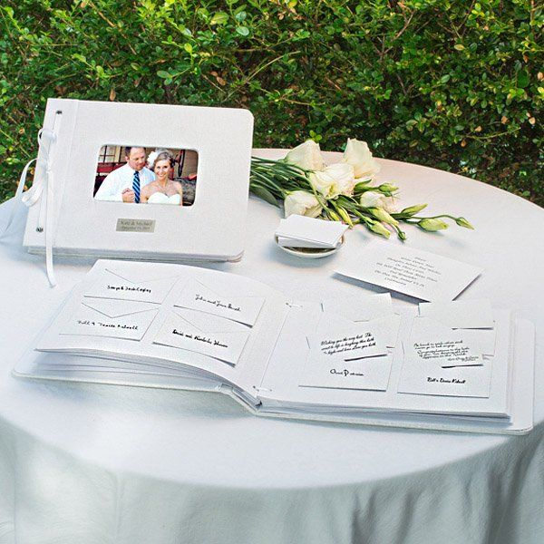 Fashioned in linen and accented with grosgrain ribbon, the Wedding Wishes wedding signature book features 132 note cards and matching envelopes for family and friends to share well wishes