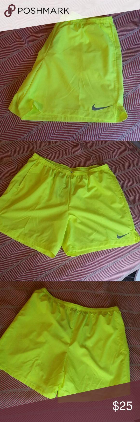 Men's Nike Dri-Fit Flex Neon Yellow Shorts Highlighter/neon yellow color. Drawstring waist, pockets, mesh side detailing. Lightweight. Reflective Nike swoosh. Nike Shorts Athletic