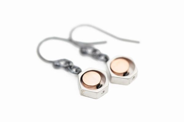 Earrings in oxidized silver with hexagon and circle beads plated with matte silver and rose gold.  Made in Oslo, Norway