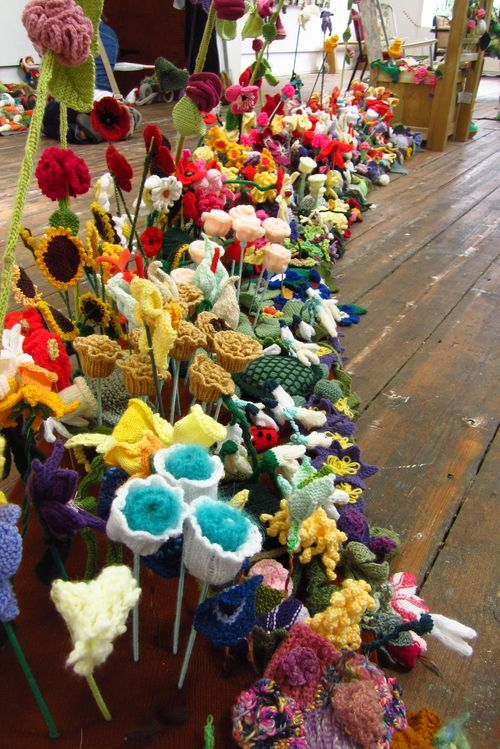 """From an exhibition at the Bridport Arts Centre UK. Exhibition called Blooming Marvellous and described as """"an intergenerational community knitting/crochet project culminating in a knitted/crocheted 3D garden."""""""