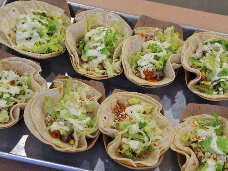 Metro Newspaper names Revolution Taco, Ela and Nick's Bar and Grille top spots for Super Bowl take-out. Tacos, wings, roast beef - touchdown.