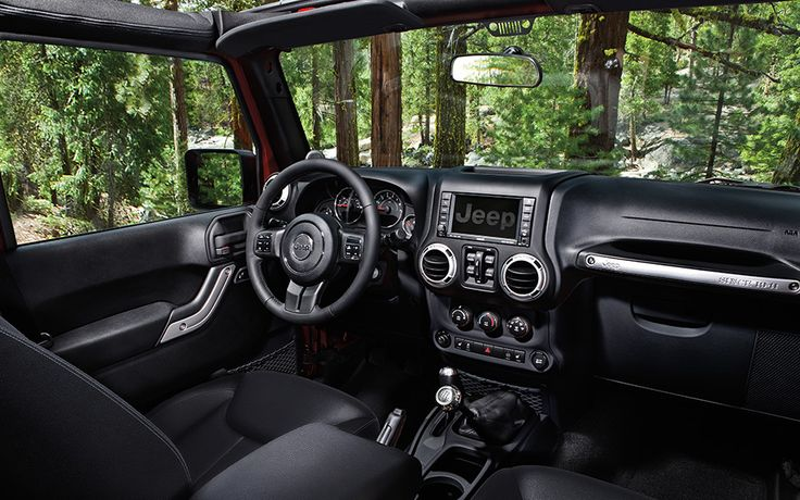 Jeep® Wrangler Unlimited Rubicon has a beautifully crafted interior that awaits your arrival. Shown in black.