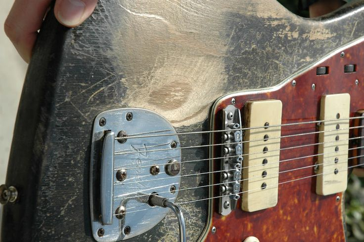 "Nels Cline's 1959 Jazzmaster has seen years of playing and abuse. Engraved into the tailpiece, you can just barely make out an engraving saying ""Watt,"" a reminder that Mike Watt originally owned this guitar."