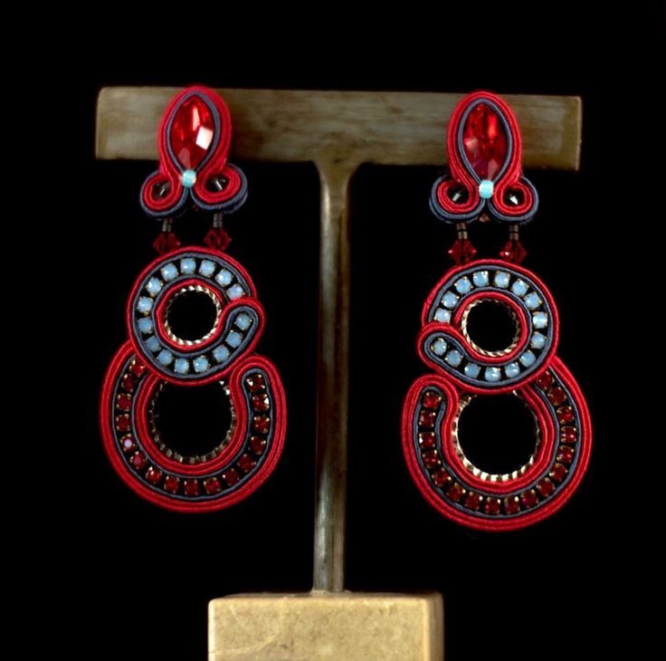 Dori's red statement earrings, designed for women who live life on their own terms! The earrings are now available at NKO  Fashion Jewelry, Costa Rica  #doricengeri #costarica #luxuryshopping #luxurybrands #designerjewelry #statementearrings #redearrings #luxeearrings