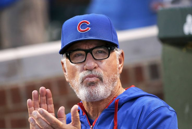 Chicago Cubs manager Joe Maddon applauds during a replay of Jake Arrieta's no hitter against the Los Angeles Dodgers, as Arieta was honored before a baseball game against the Cincinnati Reds at Wrigley Field Monday, Aug. 31, 2015, in Chicago.
