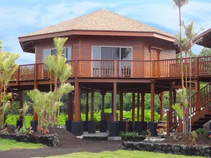 Rumah Kayu dengan Tiang Panggung Tingkat