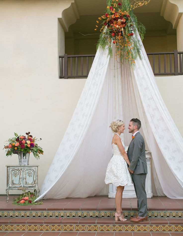 Boho chic wedding with a teepee backdrop