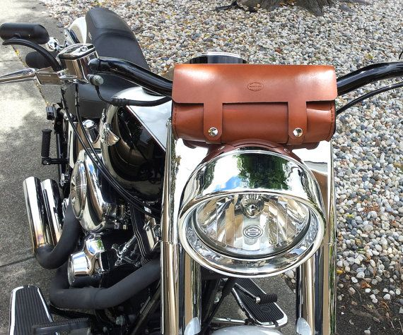 We not only produce custom leather accessories but we also build custom motorcycles. We value function just as much as form and these bags are perfect for any bike. Now available in two sizes, our original 10 inch bag and our smaller 8 inch bag, which is better suited for narrow front ends like cafe racers, Mullins style, or sportsters. ________________________________________________________________________________________  *Plenty of room for tools, registration, keys, wallet, beer, rag…