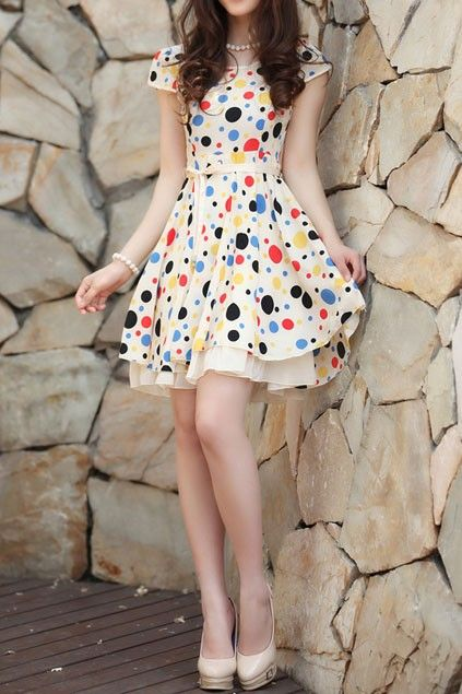 Dress crafted in suede, featuring round neck, short sleeves, all over polka dot, bound waist design with bow-knot, in a mini length cut.$86
