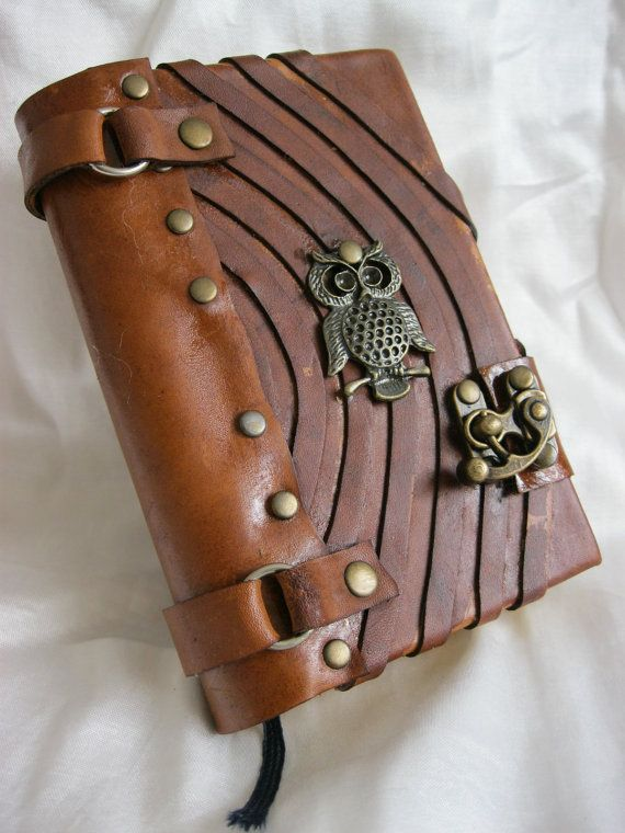 leather journal with owl decoration. Maybe not exactly like this, but anything with an owl is good!