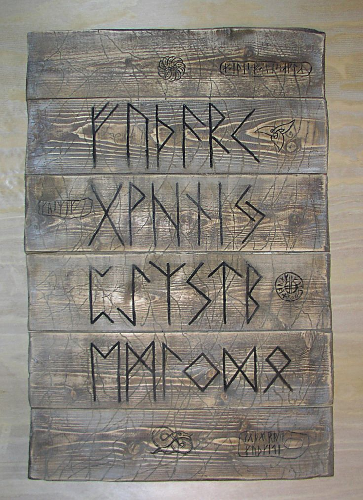 board with the runic alphabet