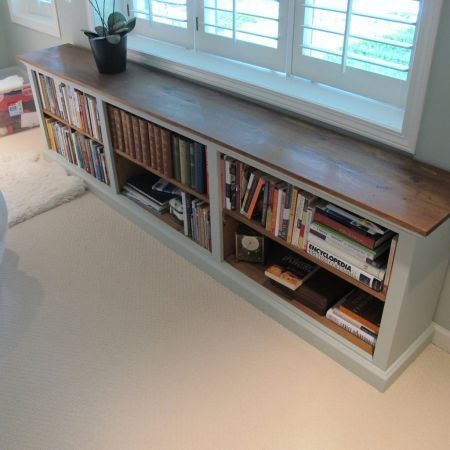 Long, low profile bookshelf. i would add a foam seat to the top, and some pillows for a place to curl up and read #sofatablebookshelf