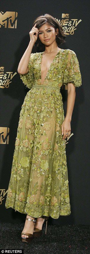 A natural: The 20-year-old wore a gorgeous green gown as she arrived at the Shrine Auditorium in Los Angeles