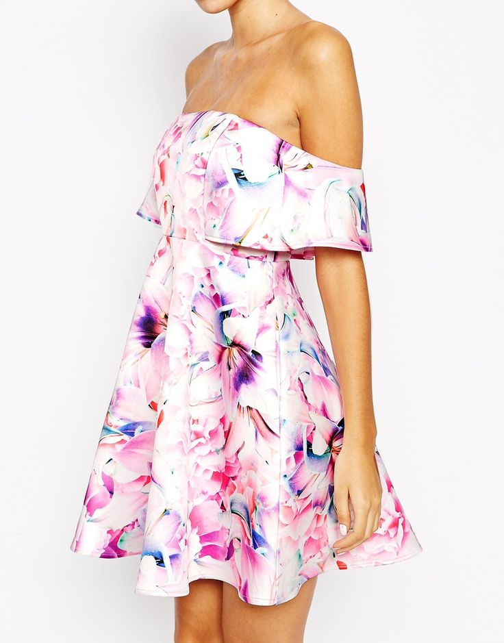 Be the cute girl at your first date. Wear this dress in floral print, white heeled sandals & double ball chocker necklace.