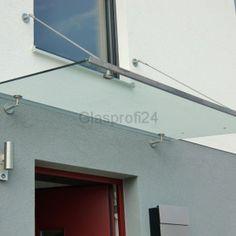Glas-Vordach mit Edelstahl