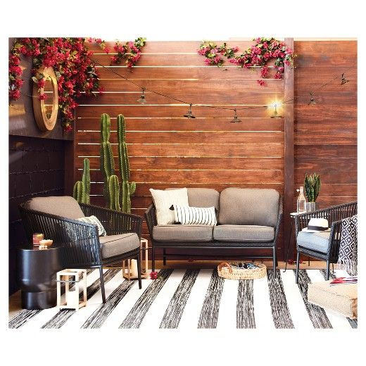 • Made of polypropylene and polyester with a latex backing<br>• Machine woven<br>• For outdoor use<br><br>Make your outdoor living space feel as comfortable as indoors with the Outdoor Rug in Worn Stripe Black from Threshold. This outdoor throw rug can be rinsed clean with water.