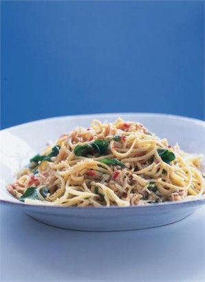 2 cloves garlic   1 scant tablespoon Maldon salt   1 large red chilli   1.25kg undressed crab, to give you 200g white meat and 100g brown meat   125ml extra virgin olive oil   Juice and zest of 1 lemon   500g linguine   Handful fresh parsley, chopped   Handful watercress leaves, roughly torn