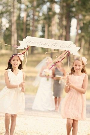 Here Comes the Bride Wedding Sign. I would have the flower girl follow after this sign. The ring bearer just before