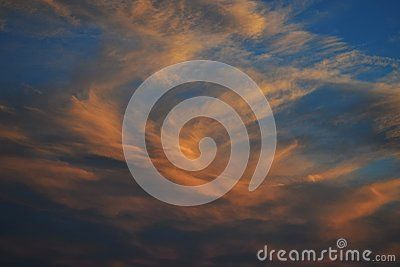 Beautiful orange clouds in the blue sky at sunset.
