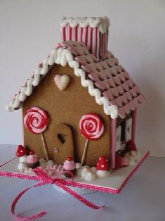 Red and pink gingerbread house. really wanna make one of these...