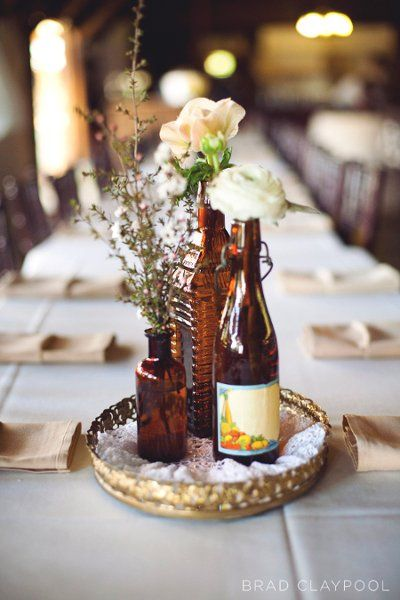 bottle centerpieces {credit: Floral Designs by Christa Rose}