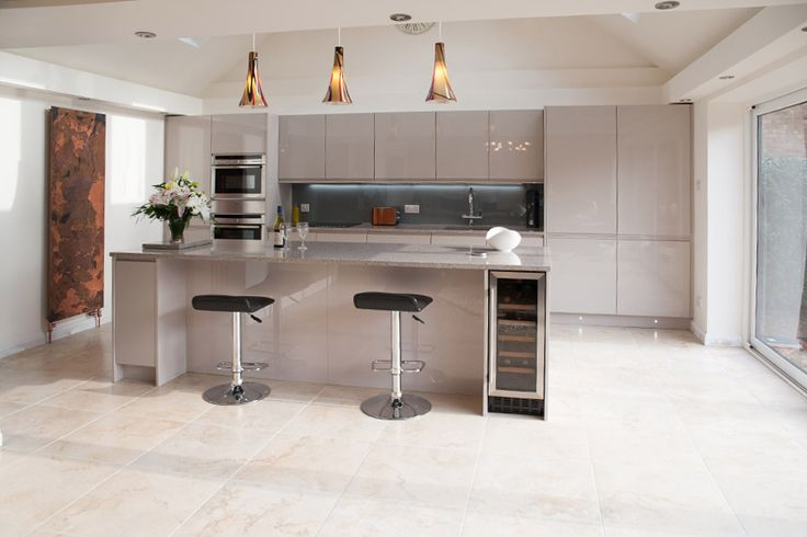Gloss Cashmere Handleless with Samsung 'Saltoro Cliff' Quartz worktop. Feature radiator byBisque. Splash back is Lustrolite 'Titan' with a Blanco Silgranite sink in the 'Alumetallic' finish, taps are Grohe Duo Red.Neff single oven, Combi Oven and warming drawer, Neff Four Zone Induction Hob, Neff Dishwasher, CDA Tall Larder Fridge and Freezer, CDA 30cm Wine Cooler,... Read More