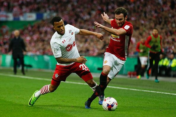 Manchester United's Spanish midfielder Juan Mata vies with Southampton's English defender Ryan Bertrand during the English League Cup final football...