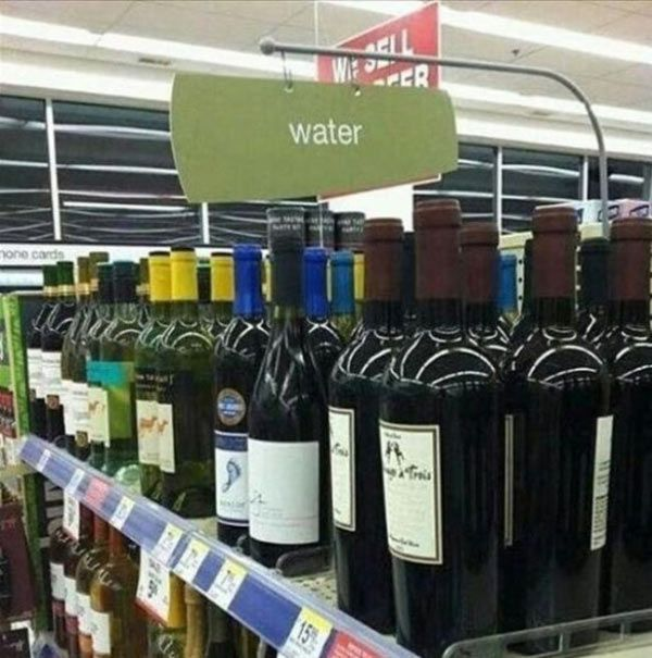 Wine rack with water sign ~ Funny You Had One Job Fails