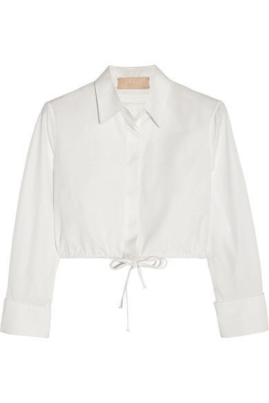 Azzedine Alaïa traces his love of creativity back to childhood, recalling memories of his twin sisters' glamorous style and reading copies of VOGUE. Part of his eponymous label's Spring '17 collection, this shirt is cut from off-white cotton-poplin with a classic mother-of-pearl button placket. Though finished with a drawstring, this cropped piece is designed to sit away from the body where it's ruched at the back.