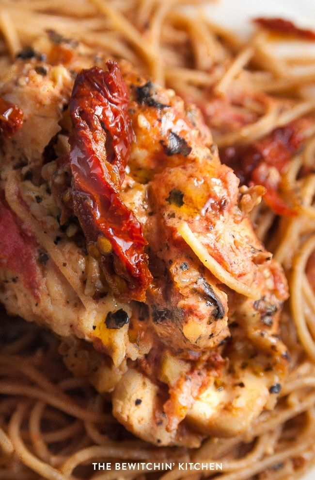 Sundried tomato stuffed chicken breasts with a creamy tomato parmesan sauce. This chicken breast recipe is delicious served over pasta or with a side salad.