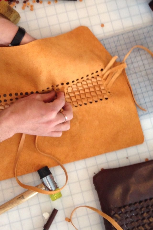 This image shows an interesting technique of threading leather strips through holes to create an effect similar to woven leather. #leathertechniques #leatherwork #wovenleather