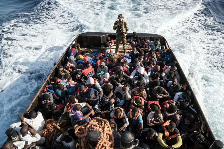 A Libyan coast guardsman stands on a boat during the rescue of 147 illegal immigrants attempting to reach Europe off the coastal town of Zawiyah, 45 kilometres west of the capital Tripoli, on June 27, 2017. (scheduled via http://www.tailwindapp.com?utm_source=pinterest&utm_medium=twpin)