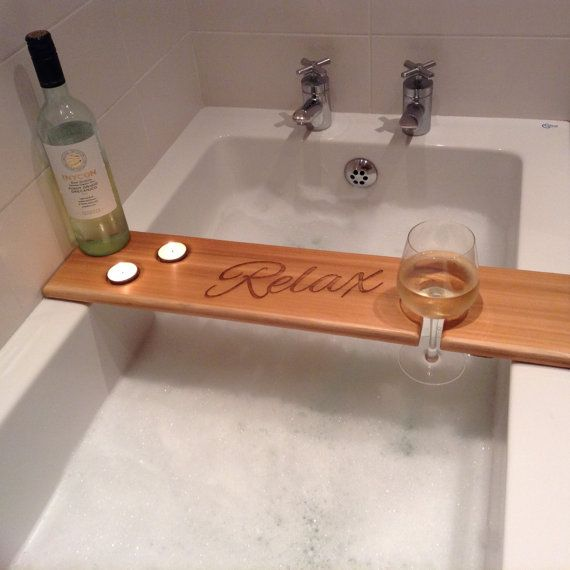 Personalised bath caddy to hold 2 tea light holders and a glass of your favourite wine.  This is made from red cedar wood and has two coats of polyurethane varnish  Sizes are approx 70cm x L X 15cm x W 2cm D  The enscription is engraved using a laser cutting machine.  Any queries please message me  Thanks Jess