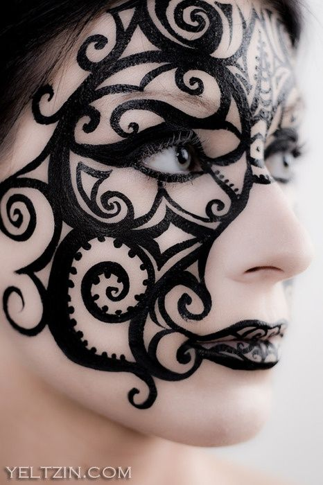 in paint halloween-makeup. Awesome idea for a masquerade mask, as long as you don't touch it all night.  (note: no link available)