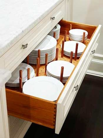 Dish Organization: Use a pegboard with tall pegs to put your dishes in the drawer and keep them from sliding around.