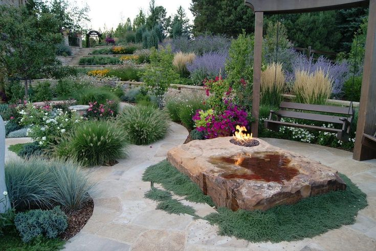 boulder fire pit landscape mediterranean with wood swing porch swings