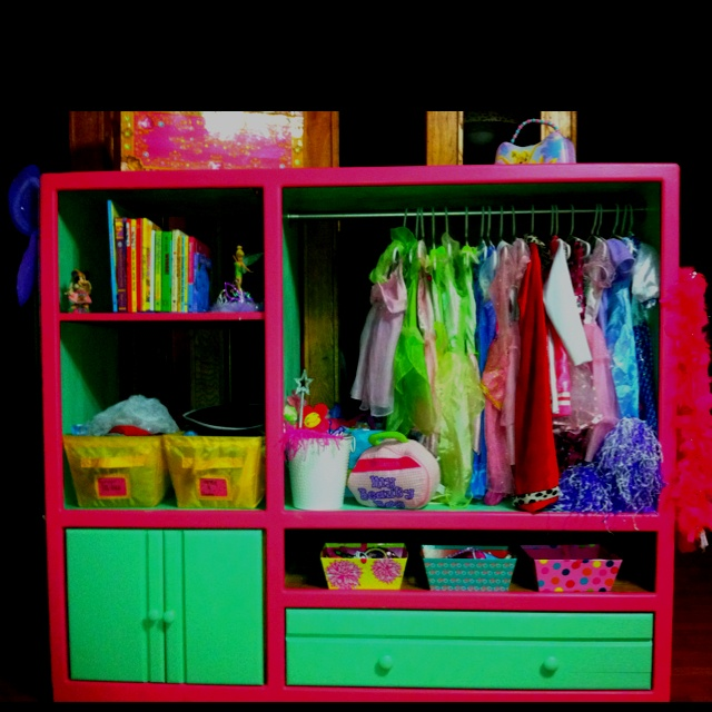 Dress up station we made for my 3yr old princess!!  Made from an old entertainment center.