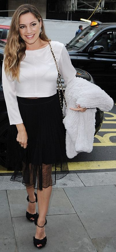 Kelly Brook wore a white satin crop top by Club Monaco and lace Rag & Bone Lyndale skirt