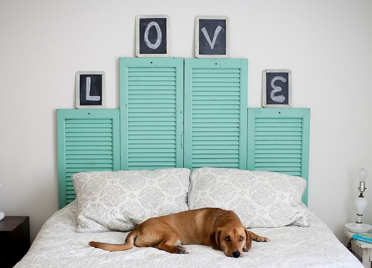 Shutters used for a unique headboard.  I would like it better if they were all the same height and the letters read across easier.  (Unless his name is Oliver and her name is Violet)  www.rehouse.com  I'd get my shutters from ReHouse and then spray paint with Rustoleum.