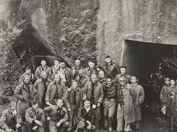 Survivors of General Jimmy Doolittle's Tokyo Raiders outside a shelter carved from a mountainside somewhere in China. 1943. The 1944 film, THIRTY SECONDS OVER TOKYO is based on the Doolittle raid.