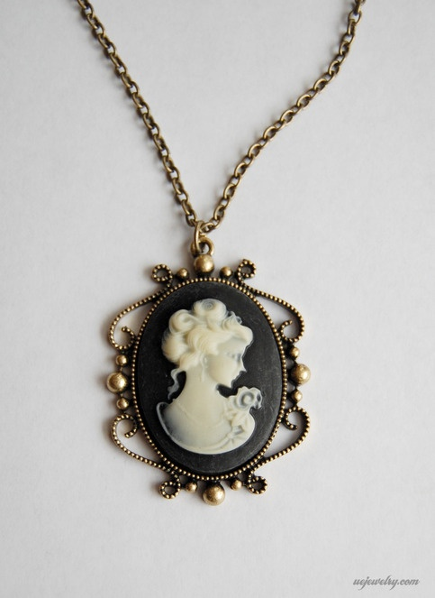 """my """"something borrowed"""" is a similar black cameo pin my mother wore on her wedding day"""