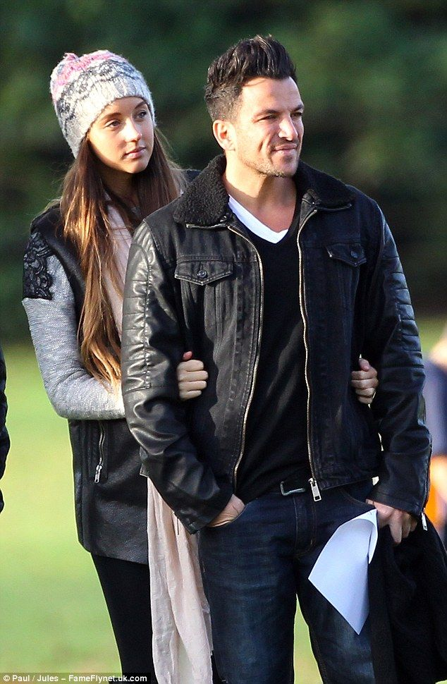 Devoted dad Peter Andre watches his children play football in the park with pregnant girlfriend Emily MacDonagh.