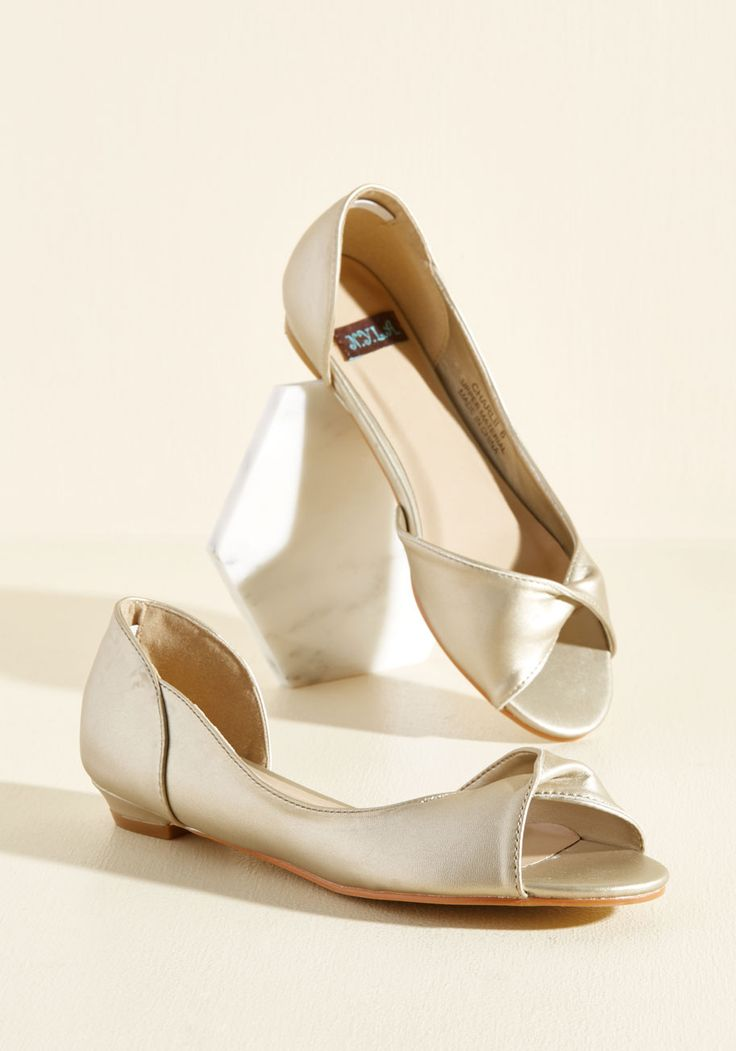 As someone who loves looking luxe, your neutrals are a little more lively than the norm. That's where these muted, metallic gold flats come in. With a timeless d'Orsay silhouette, a chic twist at each peep toe, and low kitten heels, these faux-leather basics - a ModCloth-exclusive pair - are exactly your speed!