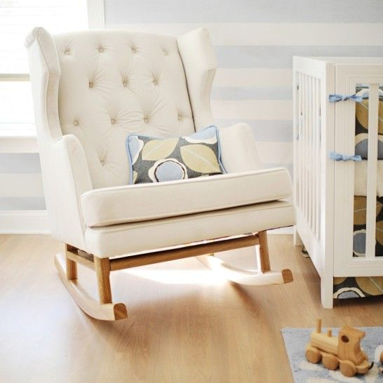 casual cushion on pale white fabric rocking chair with natural wooden curved legs on natural wooden laminate flooring