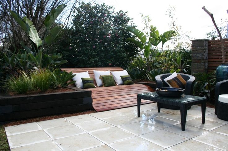 The outdoor entertainment area (landscaping and tiling) including a feature timber daybed constructed by Matthew Campbell for KMH Projects at a property in Northmead, Sydney.