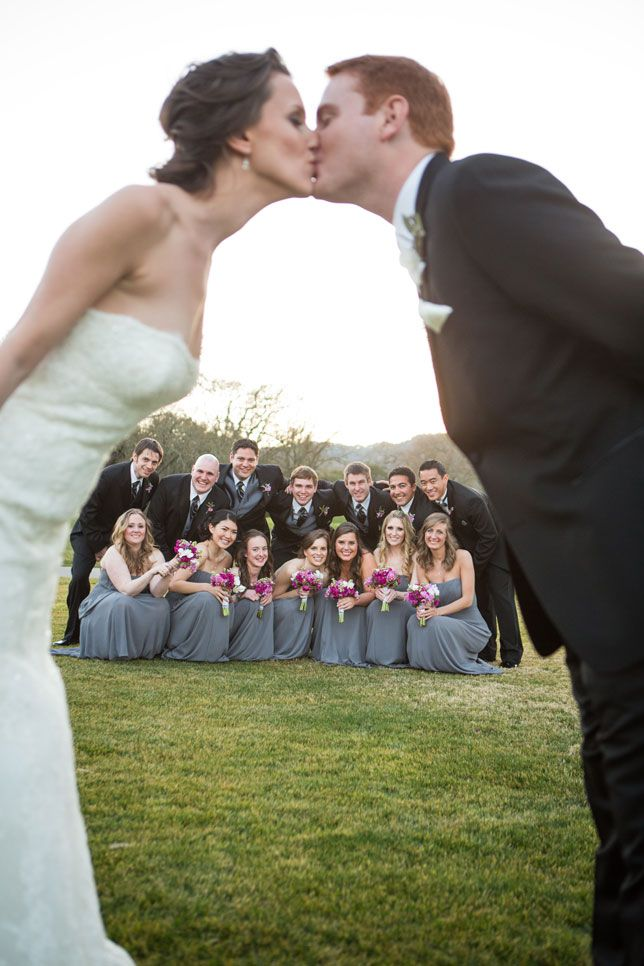 Love this shot! Great wedding photo idea with bridal party in the back. Adorable.