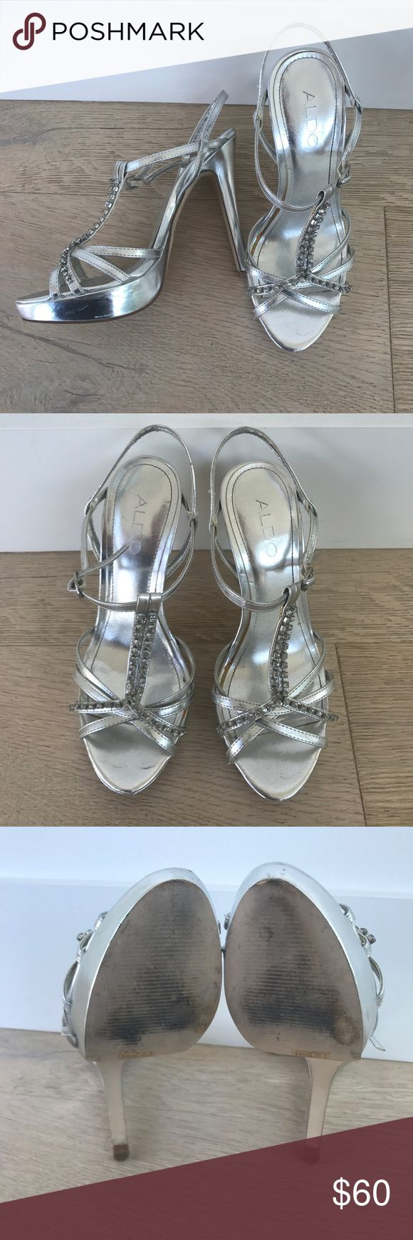 Aldo Silver Strappy Heels Flaws shown, some of the glue is exposed and the heel is lifting but could easily be stuck down. Nothing that would be visible while you were wearing them :) worn once or twice Aldo Shoes Heels