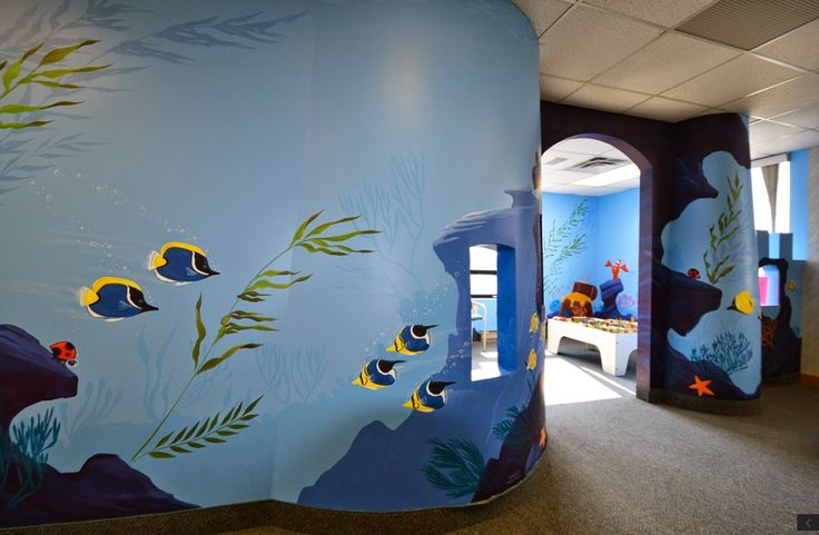 The Woodroffe Paediatric Dentistry has a custom built play area for their young visitors. Initially it was a castle design but it needed to be repaired and updated so we decided to transform it into an underwater playground. hand painted by Mural Magic in Ottawa.