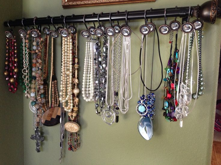 Make your own necklace hanger. I have a short wall so I used one curtain rod and two packs of shower curtain hangers. Mount with curtain brackets (use a screw in the side wall to hook the open end of the rods to keep them level). Easy!